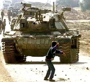 Faris Odeh (December 1985 - 9 November 2000) was a Palestinian boy shot dead by Israeli military forces near the Karni crossing in the Gaza Strip while throwing stones in the second month of theqsa Intifada. A picture of Odeh standing alone in front a tank, with a stone in his hand and arm bent back to throw was taken by a photojournalist from the Associated Press on October 29, 2000. Ten days later, on November 9, Odeh was again throwing stones at Karni when he was shot in the neck by Israeli troops. Odeh and the now famous image of him have since become symbols of the Palestinian resistance to the occupation